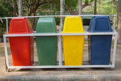 Four colorful recycle bins royalty free stock photos