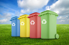 Four colorful recycle bins Stock Photo