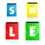 Four colorful shopping bags bearing the sale Royalty Free Stock Image