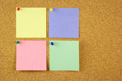 Four colorful stickers on the cork Royalty Free Stock Photo