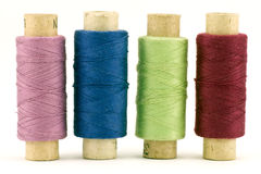 Four colorful thread spools Royalty Free Stock Images