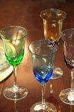 Four colorful toasting glasses Royalty Free Stock Images