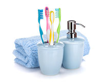 Four colorful toothbrushes, liquid soap and towel Stock Photography