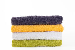 Four colorful towels. On white background Stock Photos
