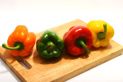 Four colors bell peppers Royalty Free Stock Photography