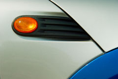 Four colors. Blinker orange color with black plastic bases on the blue white car Stock Images