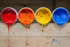 Four colors of ink for print tee shirt flowed out of barrel. Yellow orange and red colors of plastisol ink flowed out of the barrel. plastisol ink is specially Royalty Free Stock Image