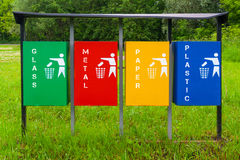 Four colors recycle bins or trash can in the park Royalty Free Stock Photos