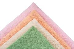Four colors towels Stock Photos