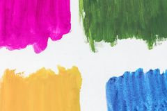 Four colors of watercolor paint on a white background royalty free stock photography