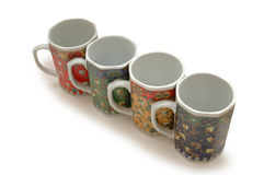 Four colorurful mugs Royalty Free Stock Images