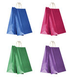 Four colour shopping bags. Isolated on white background. Clipping path Stock Images