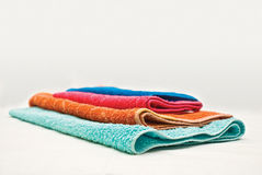 Four colour towels. On a white fabric Royalty Free Stock Photo