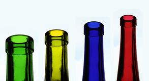 Four coloured bottles Royalty Free Stock Image