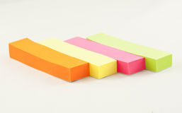 Four coloured sticks of paper Stock Photography