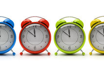 Four colourful alarm clocks isolated on white background 3D. Four colourful alarm clocks isolated on white background royalty free illustration