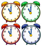 Four colourful clocks. Set of four colourful clocks on a white background Royalty Free Stock Photography
