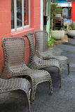 Four comfortable chairs outside red brick building Stock Photos