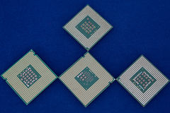 Four computer chip on the blue background. Modern technology Royalty Free Stock Photo