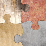 Four connected puzzle pieces of different material. 3d rendering  of puzzle set made of stone, paperboard and granite pieces Royalty Free Stock Images