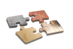 Four connected puzzle pieces of different material. 3d rendering  of puzzle set made of stone, paperboard and granite pieces Royalty Free Stock Photo