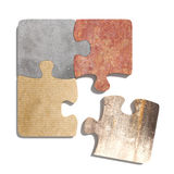 Four connected puzzle pieces of different material. 3d rendering  of puzzle set made of stone, paperboard and granite pieces Stock Images