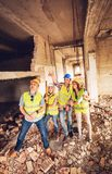 Successful Architects Team. Four construction architects in the building damaged in the disaster. Planing reconstrustion Royalty Free Stock Photos