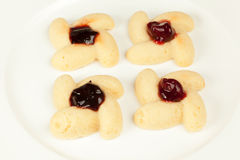 Four cookies with preserved cherry Stock Photography