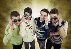Four cool guys in eyeglasses Royalty Free Stock Images