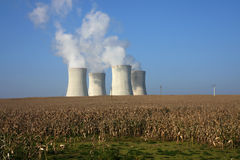 Four cooling towers in  agriculture field Royalty Free Stock Photo