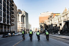 Four Cops using Bike for Fast and easy Moving. Royalty Free Stock Photos