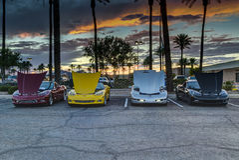 Four Corvettes at Sunset. SCOTTSDALE, AZ - SEPTEMBER 5: Four classic Chevrolet Corvettes photographed against the sunset on September 5, 2015 in Scottsdale Royalty Free Stock Photos