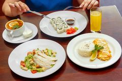 Four-course dinner combo, salad, soup, hot. Business menu Combo set dinner, four-course dinner, Caesar salad, soup salted, pickle with lemon and sour cream, rice Royalty Free Stock Images