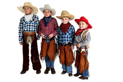 Four cowboy brothers standing wearing hats and cha stock images