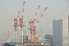 Four cranes on a new building Royalty Free Stock Photography