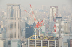 Four cranes on a new building Royalty Free Stock Photo