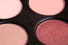 Four creamy pink and brown eye shadows for make up Stock Photography