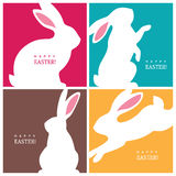 Four creative design concepts with Easter bunnies. Set of four creative design concepts with white bunny silhouettes for Easter greeting card, banner or poster Royalty Free Stock Images