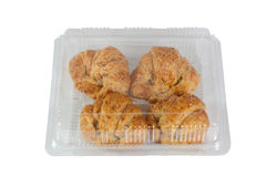 Four croissant in a clear box. Royalty Free Stock Photo