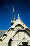 Four Crosses On Top Of A Church. The old wooden church of Pulkkila, Finland has an interesting roof structure and decorations royalty free stock photo
