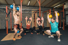 Four Crossfit Trainers Workout Royalty Free Stock Images