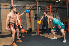 Four Crossfit Trainers Workout Royalty Free Stock Photography