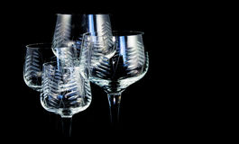 Four crystal glasses. On black background Royalty Free Stock Images