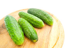 Four cucumbers on cutting board Royalty Free Stock Photo