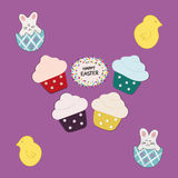 Four Cupcakes  on purple background Stock Photography