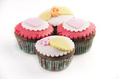 Four cupcakes  on white background Royalty Free Stock Photography