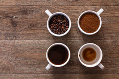 Four cups of coffee. Four phases of coffee drink Royalty Free Stock Images