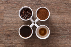 Four cups of coffee. Four phases of coffee drink Stock Image