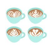Four cups. Different drawings on coffee foam. Royalty Free Stock Photo