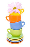 Four cups and pink flower Royalty Free Stock Photos